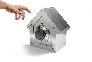 a house shaped locked safe for protecting valuable items